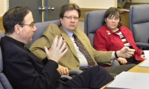 Arnold Drung and Anne Taylor listen as President Bugbee (l) adds to the discussion at a recent Board of Directors meeting.